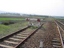 Al-Akkari railway station, looking west. The former Palestine Railway route to طرابلس (لبنان) to the left and the route to the port city of طرطوس to the right