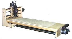 CNC wood router - A typical CNC wood router with suction holes visible