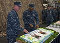 Cake cutting during change of command 141226-N-NR851-082.jpg
