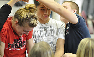 "Michigan High School Athletic Association - Students work to untie a ""human knot"" at a Captains Clinic"