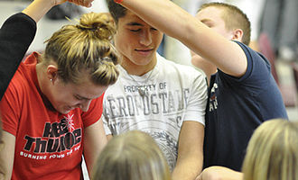 """Michigan High School Athletic Association - Students work to untie a """"human knot"""" at a Captains Clinic"""