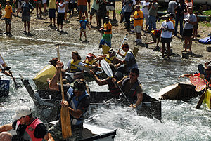 Cardboard boat race - US Navy personnel paddling cardboard boats in Guantanamo Bay