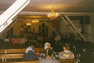 Cathedral of the Immaculate Conception (Moscow) - Congregants praying in the temporarily adapted church, c. 1993