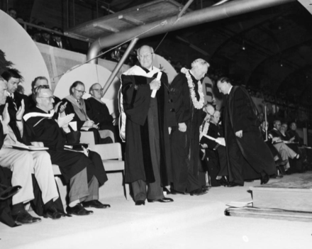 DeMille (middle, standing) receives an Honorary Doctorate degree at Brigham Young University commencement, 1957 Cecil B. DeMille receives an Honorary Doctorate degree from Brigham Young University commencement 1957.png