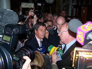 Michael McDowell (politician) - McDowell (right) announces his retirement.