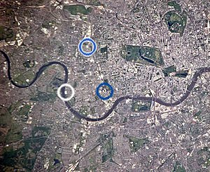 West London derby - Few English football teams are as geographically close as neighbours as Fulham and Chelsea. This satellite image of West London shows Fulham's Craven Cottage (circled in white) and Chelsea's Stamford Bridge (blue), just 2.2 km apart. QPR's Loftus Road ground is also shown to the north (blue edged in white). Brentford's ground is just beyond the left (west) of the satellite image, above the bend in the River Thames.
