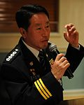 Chief Na Yu-In, Gunsan Korean National Police chief, addresses 8th Security Forces Squadron Airmen following a lunch at the Loring Club here May 3 (USAF photo 110503-F-JK379-023).jpg