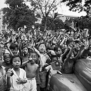 Children cheering the arrival of the 5th Indian Division in Singapore, 5 September 1945. SE4662