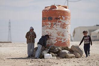 Zaatari refugee camp - Syrian Children filling drinking water in bottles at Al-Zaatari camp for Syrian refugees in Jordan. (By/ Mustafa Bader)