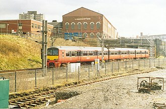 Strathclyde Partnership for Transport - The orange and black colourscheme of the Strathclyde PTE is illustrated on a Class 320 unit seen at Coatbridge Sunnyside station in April 1994.