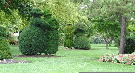 Columbus artist James Mason's French Topiary Gardens at the Old Deaf School Park, constructed in 1989 in downtown, was conceptually conceived from Georges Seurat's A Sunday Afternoon on the Island of La Grande Jatte . Columbus Topiary Gardens.jpg