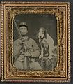 Confederate soldier with shotgun sitting next to dog.jpg