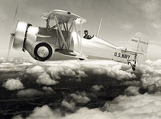Curtiss F11C Goshawk - Curtiss XF11C-3 variant flying over the clouds with landing gear and tailhook retracted