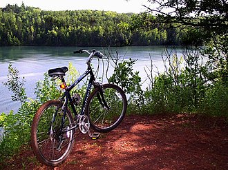 Cuyuna Country State Recreation Area - A mountain biking trail overlooking a pit mine lake