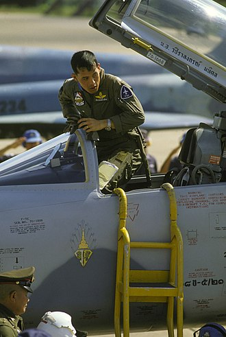 Vajiralongkorn - Vajiralongkorn of Thailand climbs out of the cockpit of an F-5E Tiger II aircraft