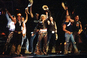 Don't Tell Me (Madonna song) - Madonna and her dancers dressed as cowboys, do a line dance routine similar to the music video, during the performance of the song on the Drowned World Tour, 2001