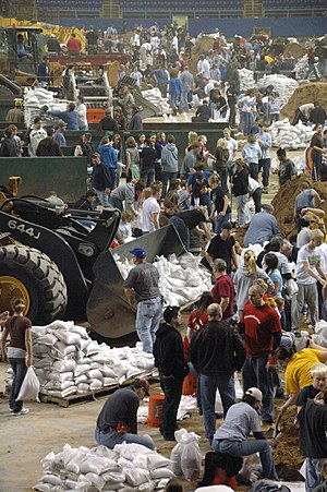 Fargodome - Volunteers fill sandbags in the Fargodome during the 2009 flood.