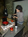 Dipping wine bottles in wax as a seal.jpg