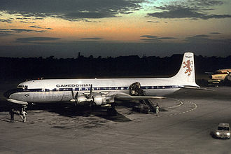 Caledonian Airways - Caledonian Douglas DC-7C wearing the original colour scheme at Manchester in July 1964 when operating an inclusive tour service to Barcelona