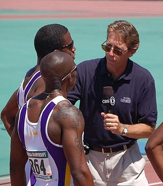 Kelly Willie - Willie (foreground) being interviewed by Dwight Stones in 2006
