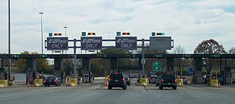 Electronic toll collection - EZ Pass Tollbooths, like this one at the Bensalem Exit 351 on the Pennsylvania Turnpike, use transponders to bill motorists.