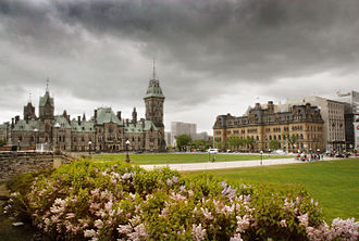 Architecture of Ottawa - After Confederation, the federal government constructed a series of monumental structures, including the Victorian High Gothic Parliament buildings (left), and the Second Empire-styled Langevin Block (right).