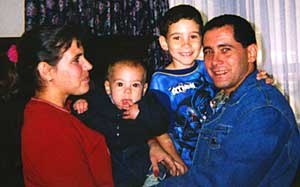 Elián González - Elián González poses with his father, stepmother and half-brother in a photo taken a few hours after their reunion at Andrews Air Force Base.