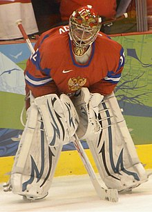 Russian Hockey Goalie Drinks Water During Play