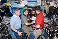 Expedition 27 crew members discuss mission activities in the Destiny lab.jpg