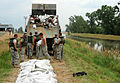 FEMA - 36153 - Missouri National Guard use sandbags to build a levee.jpg