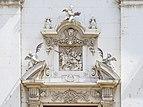 Facciata principale altorilievo Santo Calegari chiesa San Faustino e Giovita Brescia.jpg