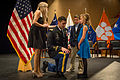 Family pins 2nd lieutenant at ROTC commissioning ceremony 141217-A-ZU930-001.jpg