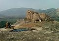 Far view of Buddhist temple ruins at Bodhikonda.jpg