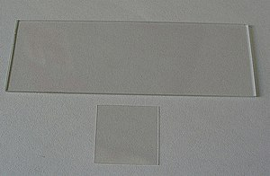 Microscope slide - A microscope slide (top) and a cover slip (bottom)