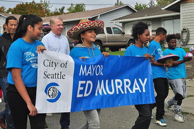 https://upload.wikimedia.org/wikipedia/commons/thumb/5/5f/Fiestas_Patrias_Parade%2C_South_Park%2C_Seattle%2C_2015_-_003_-_Mayor_Ed_Murray%2C_et._al_%2821373226398%29.jpg/640px-Fiestas_Patrias_Parade%2C_South_Park%2C_Seattle%2C_2015_-_003_-_Mayor_Ed_Murray%2C_et._al_%2821373226398%29.jpg