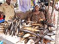 Fish seller in market, Ghana.jpg