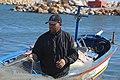 Fisherman in his boat at the port of Hergla, Tunisia.jpg