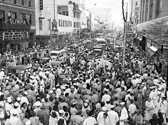 Miami-Dade County, Florida - Crowds on Flagler Street in Downtown Miami on August 15, 1945, 20 minutes after the announcement of Japan's surrender at the end of World War II