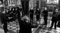 Flavio Colusso dirige il coro polifonico.png