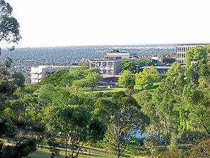 Flinders University - View of Flinders University main campus, with central plaza and lakeside area visible.