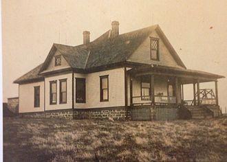 Folk Victorian - Midwestern home built in 1904. Modest exterior, interior features much woodwork