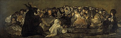 In an array of earthen colors, a black silhouetted horned figure to the left foreground presides over and addresses a large circle of a tightly packed group of wide-eyed intense, scary, elderly and unruly women.