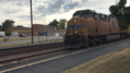 Freight Train Passing Through Melrose Park METRA Station.png