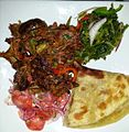 Fried Goat Chapati Veges Spices.jpg