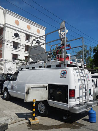 ABS-CBN (TV network) - An ABS-CBN news van in front of the Office of the Ombudsman building.