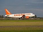 G-EZIM easyJet Airbus A319-111 landing at Schiphol (EHAM-AMS) runway 18R pic3.JPG