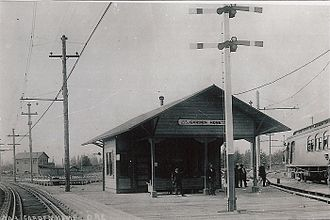 Garden Home–Whitford, Oregon - The Oregon Electric Railway's Garden Home Railway Depot circa 1911. This structure stood on a trestle at the intersection of Multnomah Blvd and Garden Home Rd. Tracks on the left continued south to Nesmith, Metzger, and Greenburg. Tracks on the right continued northwest to Firlock, Fanno Creek, Whitford, and Beaverton.