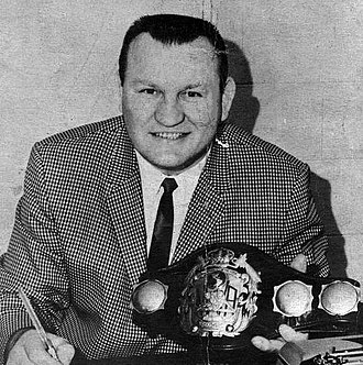 NWA World Heavyweight Championship - Gene Kiniski poses with an older design of the championship in 1966