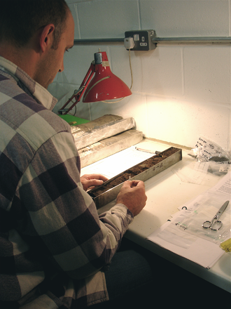 Geoarchaeology - geoarchaeologist at work on column sample