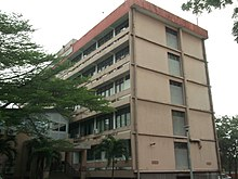 Tan, five-story building